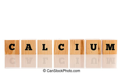 The word - Calcium - on wooden blocks with a reflection and...