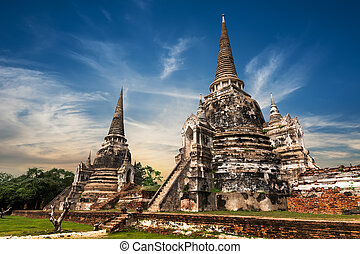 Ancient Buddhist pagoda ruins at Wat Phra Sri Sanphet temple...