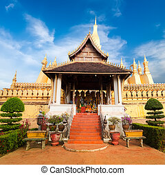 Laos travel landmark, golden pagoda wat Phra That Luang in...