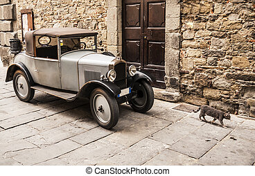 Old automobile in a street in Cortona, Italy