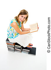 Education is everything - Woman sitting on top of many books...