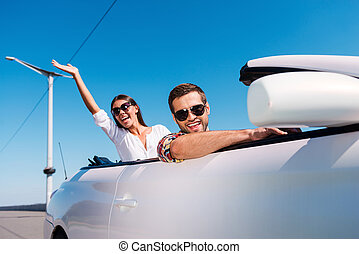 Traveling with fun Happy young couple enjoying road trip in...