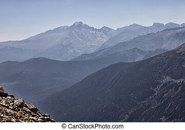 Mountain Peaks - Layered mountain peaks viewed from summit...