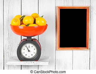 Lemons on scales on a wooden shelf. A framework on a wooden...