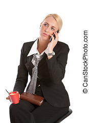 Waiting on the phone - Attractive young business woman...