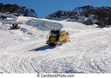Snow Transport - A snow grooming machine grooming the...
