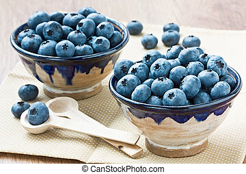 Blueberry - Two cup with ripe blueberry for healthy...