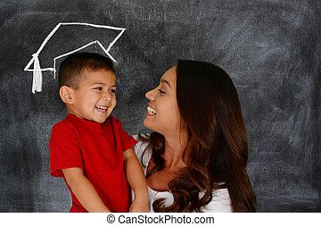 Child Graduation - Young boy holding his books before school