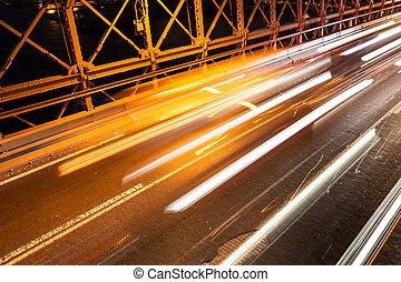 Car traffic on Brooklyn Bridge in New York - USA