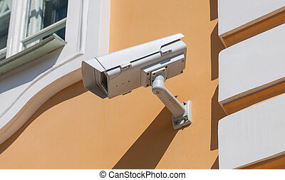 Security or cctv camera on wall background