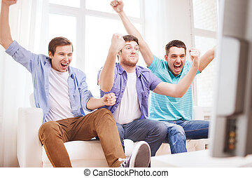happy male friends at home - friendship, sports and...