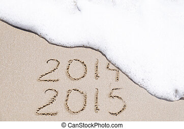 Sign quot;2014 and 2015quot; on the beach - Sign 2014 and...