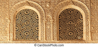 Arches in Islamic (Moorish) style in Alhambra, Granada,...