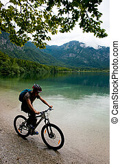 Biker on the shore - On the mountain bike on the shore of...