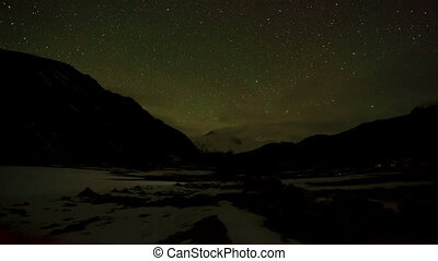 Time lapse of stars behind mountain - Time lapse of the...
