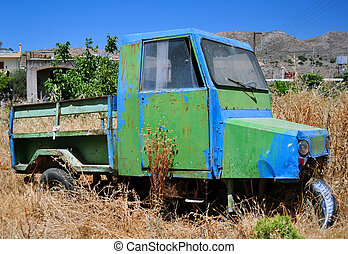 Old farm vehicle - Abandoned vehicle in rural area, island...