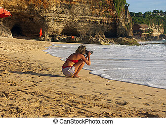Photographer on the beach - Female photoghrapher,...