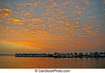 Boats anchored at dusk - Yachts anchored at Benoa port,...