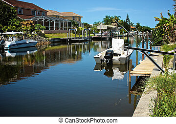 residential canal in florida - looking down along a...