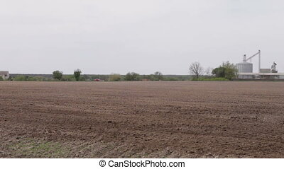 car driving on a road plowed field of granaries - car...
