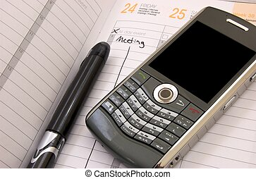 Friday Meeting - Planner with pen and smart phone showing a...