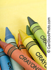 Bunch of crayons - Bunch of colorful crayons on a yellow...