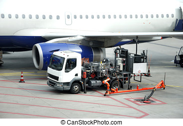 Refueling an airplane - airplane is being refueled in the...