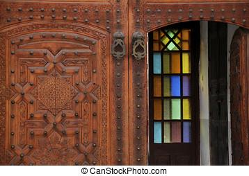 Decorated door in the medina of Marrakesh, Morocco -...