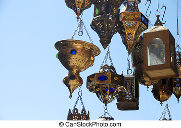 lamps in a store in marrakesh morocco with clear blue sky at...