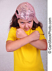 cool teen age girl with a cap posing and gesturing