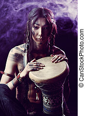 playing drum - Portrait of the American Indian. Ethnicity...