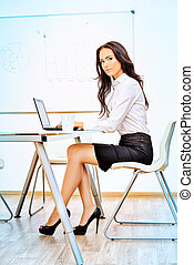 workplace - Portrait of young businesswoman working in the...