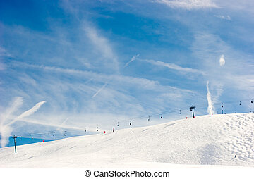 Chairlift at ski resort, French Alps