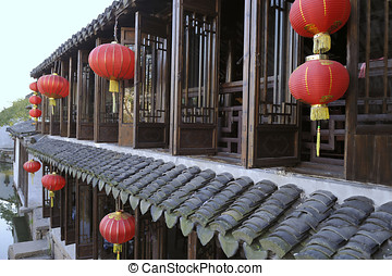 House with red lampions in Zhouzhuang - Zhouzhuang, one of...