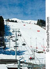 Chairlift beside a piste Meribel ski resort, French Alps
