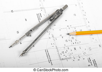divider and pencil on architectural blueprints