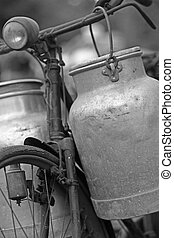 old bike of the milkman with milk cans - rusty old bike of...