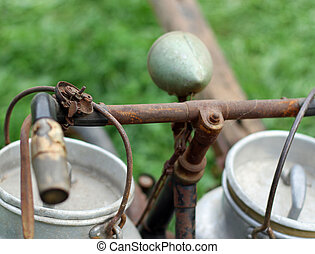 old bike of the bellboy for carrying milk with milk bins -...