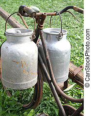 bike of the milkman with two old milk cans - very rusty old...