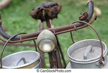 old bike lights milkman with two aluminium cans for milk...