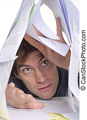 Man and paperwork - Man trapped under pile of paper work