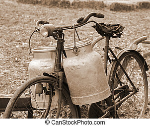 Rusty bike of a milkman of the last century with two bins -...