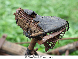 bike saddle, completely destroyed of the last century -...