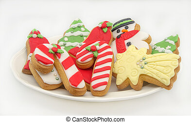 Christmas cookies decorated with fondant served on a plate