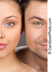 Closeup portrait of beautiful happy couple. half face of...