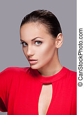 closeup portrait of beautiful woman with clean face skin. Glamorous young woman in red shirt on grey background