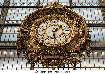 PARIS -SEPTEMBER 7, 2014: Golden clock of the museum D'Orsay...
