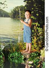 See My Fish - A young boy on overall shorts happily showing...