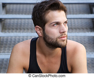 Handsome young man with beard looking away - Close up...