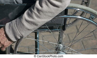 Starting Wheel-Chair - Close up of male hands starting to...